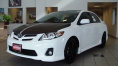 2012 Toyota Corolla S Black wrap on hood, roof, and spoiler with white racing stripes. TRD Lowering springs. Tenzo Wheels, Falken Tires. At Toyota of Escondido!