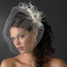 Truly lovely, this Austrian Crystal Birdcage Veil with Feathers is a gorgeous composition of luxurious white feathers, luscious Austrian crystals and radiant glass beads  This charming headpiece lends a sense of old fashioned vintage grace and elegance to any occasion
