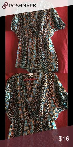 Floral multi colored romper Floral multi colored romper, slip on, v neck. Shoulder down total measures 32 inches. Waist down measures 14 inches. Waist across laying flat measures 16 inches. Great for casual settings, never been used. Pants Jumpsuits & Rompers