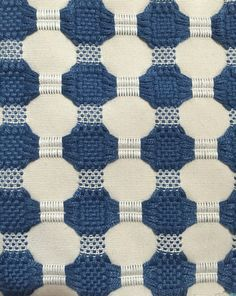 Woven Navy Dot Modern Upholstery Fabric A simple yet modern dot pattern, using dark blue and white. This fabric would be suitable for upholstery,