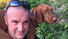 Firefighter Carries Injured Dog All The Way Down A Mountain - Rue the Vizsla was afraid of fireworks and ran out of her yard, and was found 3 miles from home with injured paws.