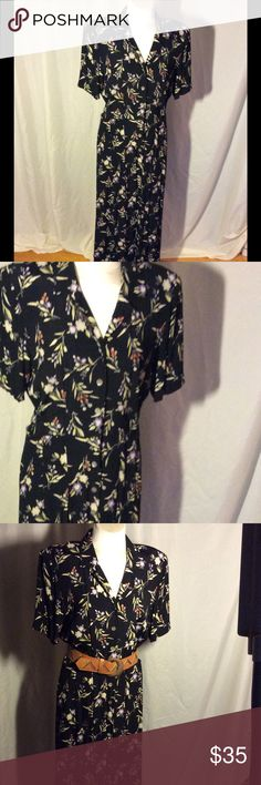 Classic black dress with dainty flowers Classic Liz Claiborne black dress with Dainty flowers it buttons down the front has two wonderful pockets I love these dresses once I was on a cruise in Hawaii and they lost my luggage I had on a dress button down the front I had capris and a tank top a shawl and I made 20 outfits Liz Claiborne Dresses Midi