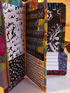 """Rough Around the Edges: file folder art journal """"The Folder Journal is made by sewing paper and fabric onto a manilla folder, then folding and stitching little pockets in it for your journal papers."""""""