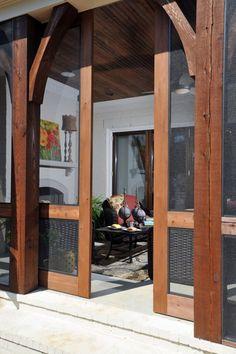 Wood sliding doors on a screen porch.
