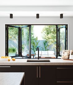 Bi-fold windows are perfect for a servery. A simple way to bring a café-like feel to your living areas.