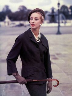Elegantly tailored flannel suit named Jolie Madame, photo by Tom Kublin, 1956 by dovima_is_devine. Pierre Balmain