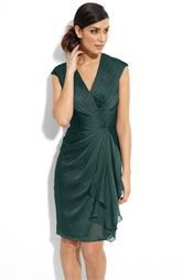 A short style in a green gemstone shade (spruce) is the perfect little number for a Mother of the Bride/Groom. Not only do we love this color, but we love the faux wrap style of this frock!
