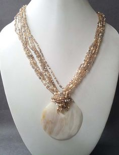 I really love this.. it's like pearls.. always classy! ....seed bead necklace