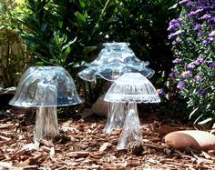 Glass mushrooms made from glass bowls and vases found at the thrift store. Would paint with glow in the dark paint!