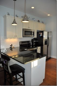 Uba Tuba granite on white cabinets