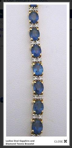 14k yellow gold ladies sapphire and diamond bracelet. The sapphires are 11.98ctw and the diamonds are 0.53ctw.