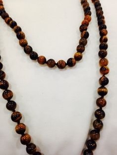 Nemesis hand knoted vintage tiger's eye beaded necklace by NemesisNYC on Etsy