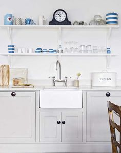 Neutral County Kitchen with Shaker-style Units and Butler Sink