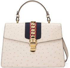 Shop the Sylvie medium ostrich top handle bag by Gucci. The Sylvie bag in a  top handle shape with nylon Web embedded under the leather and decorated  with a ... 32ba4a1b84327