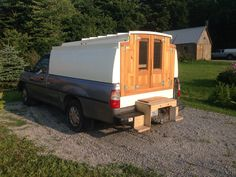 Home built camper on a Toyota T100 truck.