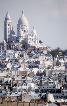 Sacre Coeur, Paris - it was so hot, and very crowded: sellers of plastic Eiffel Towers, beggars, camera-carrying tourists, soldiers with automatic rifles. Then a busker with a harp began to play Pachelbel's Canon in D, and all the tension disappeared. Ah, memories!
