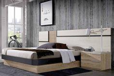 Dormitorio de matrimonio compuesto de cama abatible con panel cabecero corrido y mesitas para colchón de 150x190cm. Mide 350x198cm. Se puede complementar con un sinfonier vestidor zapatero de 141x42cm. Acabado en color taiga, nogui y laca antracita, con tirador blanco. Dispone de más colores para que diseñe el mueble a su gusto.