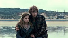 YEAR 7: Ron comforts Hermione after Bellatrix Lestrange killed Dobby, who had helped them escape Malfoy Manor. (Warner Bros. Pictures)