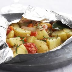 Een overheerlijke aardappel- en groentepapillot, die maak je met dit recept. Smakelijk!