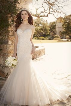 c102f0f739 (sp) This body-hugging satin fit and flare wedding gown with a tulle