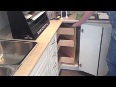 For blind kitchen cabinet solution, Gillingham Cabinet, combination lazy susan and drawer organizer.