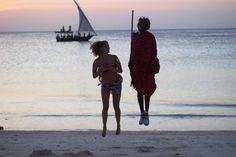 Jumping with a masai boy in Zanzibar!