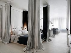 faux canopy bed- great way to break up a big loft space and make it a bit more cozy