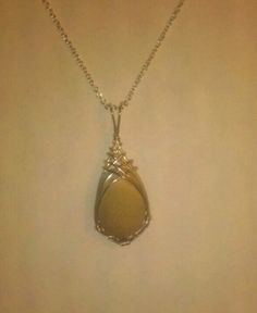 Wire wrapped pebble from a trip to Florida..