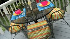 want my back patio chairs to look like this!!  Tutorial on making cushions.