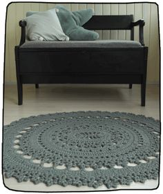 Pattern for a crocheted oval doily rug. Classic medallion shape brings a new dimension to crochet rugs. Sample rug is crocheted with Novita Tuubi in hook 8 and it measures approximately 70 x 130 cm x 51 inch).