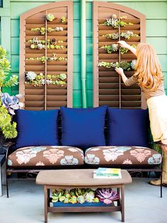 Twin shutters bring a room-like appeal to this outdoor deck. Tiny succulent rosettes peek out from openings between the slats. To hold the rootballs in place, weed-cloth pockets are stapled behind each shutter. (Photo: )