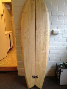 Stick wooden surfboards