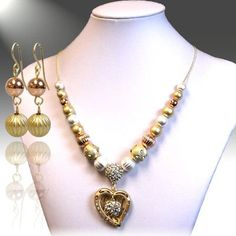 Accessory Accomplice Rose Goldtone, Goldtone & Silvertone Heart Pendant Adjustable Necklace & Earring Set Accessory Accomplice http://www.amazon.com/dp/B00BM7UHOE/ref=cm_sw_r_pi_dp_IKn-tb1S0WSH0
