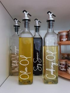 olive oils Buy these high-quality Oil & Vinegar Glass Bottle with Pourer made of stainless steel. This oil bottle pourer comes in a single bottle and a set of 4 bottles. Put olive oil, vege Kitchen Organization Pantry, Home Organisation, Organization Hacks, Olive Oil Bottles, Olive Oil Jar, Olive Oils, Olive Oil And Vinegar, Pantry Labels, Spice Labels