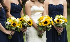 Bridal and bridesmaid bouquets with sunflowers, stock, daisy chamomile, viking poms, solidago and baby's breath with eucalyptus and pittosporum greenery.