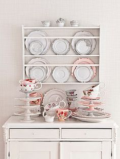 plate rack.. I am searching for something like this to display my fun cookbooks in my pantry.