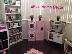 Kid's toy room.  Kenmore wooden washer/dryer & refrigerator from Kmart, wooden kitchen and bookshelf from IKEA.  efl