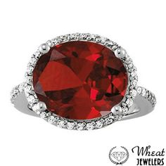 Sideways Oval Halo Colored Stone Engagement Ring available at Wheat Jewelers