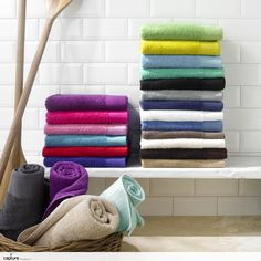 Great shot of multicoloured stacked and rolled towels photographed against white metro tiles. Contemporary and fresh bathroom idea by http://capture.setvisions.co.uk/Portfolio