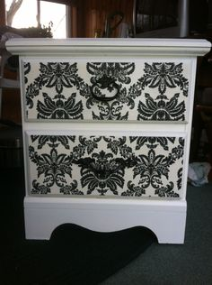 Give your dressers a face lift! 1. spray paint dresser in color of your choice and let dry completely. 2. measure the face of drawers and cut out wallpaper pieces according to size. 3. roll paper loosely ( pattern side in ) and submerge in warm water for 15-30 seconds. 4. smooth paper into dresser drawers and trim any edges. 5. let dry over night then replacd handles ( after spray painting with color of your choice! ) ENJ0Y! :)
