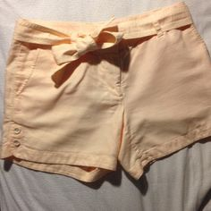 EUC JCrew soft peach linen/cotton shorts w tie sz4 EUC JCrew retail super soft shorts in a linen / cotton blend. Pretty light peach color, with tie belt and covered button detail in leg. Worn twice tops, in perfect condition!! J. Crew Shorts