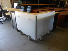 Contemporary style reception desk with frosted panels, transaction top, wheelchair access and tons of storage is in stock and ready to go. This desk looks great and would go nicely in a mall store, lobby, reception, loft, apartment, cell phone store or anywhere else you want to put it.