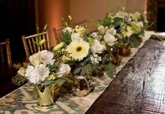 Beautiful low centerpieces by @Morrison Floral in white, green and gold. Design by @Embellished Weddings Amanda Taylor. Photo by @Kalee Ridings Photography. #wedding #centerpieces #white #gold #rustic