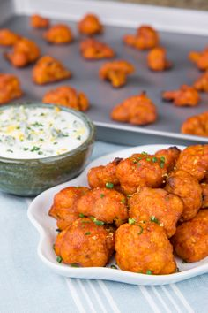 Spice up the veggie platter at your next party by serving Buffalo Cauliflower Bites with Sriracha-Lime Sauce from Bobby of @flavcity on our blog.