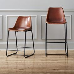 roadhouse leather bar stools :: Handmade leather composite with natural hide tones and markings saddles a contoured seat edged with a handsewn whipstitch and brass-painted rivets. Brass Bar Stools, Acrylic Bar Stools, White Bar Stools, Leather Counter Stools, Counter Height Bar Stools, 30 Bar Stools, Modern Bar Stools, Kitchen Stools, Bar Chairs