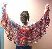 Mezzaluna Crescent Moon Wrap - free crochet shawl pattern by Nancy P on Ravelry. There are lots of project variations to see.