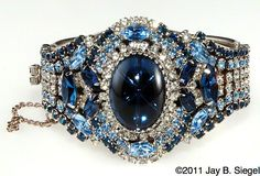 vintage beauty - Sapphire Cabochon center stone, mixed with smaller sapphires, diamonds and aquamarine.