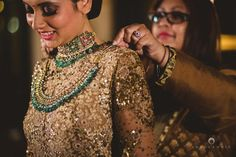 emerald and gold necklace, jadau and polki necklace layered. jewellery with high neck gold outfit,Into Candid Photography