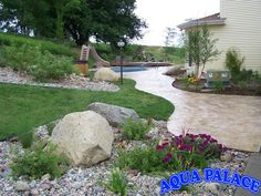 Hand stamped and stained concrete leading to pool.  Aqua Palace  810 Woodbury Ave  Council Bluffs, Iowa 51503  712-329-4180  www.aquapalace.com