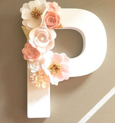 One of a kind handmade felt floral letter handcrafted just for you. Lay flat, lean against the wall or hang. Perfect for a nursery or wall hanging in kids room. Makes a beautiful baby shower gift too!  Listing is for one floral letter with felt flowers in a clustered style. Letter is made from wood, lightweight and hand painted in white, approximately 8 tall. Embellished with hand rolled felt flowers.  ** Choose alphabet (capital letter) A - Z. Please include desired letter choice in Notes…